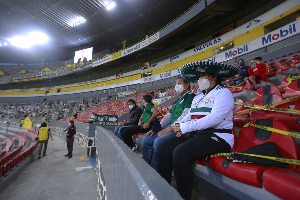 GUADALAJARA, MEXICO - MARCH 24: Fans of Mexico sit on the stands prior to the match between Mexico and USA as part of the 2020 Concacaf Men's Olympic Qualifying at Jalisco Stadium on March 24, 2021 in Guadalajara, Mexico. (Photo by Cesar Gomez/Jam Media/Getty Images)