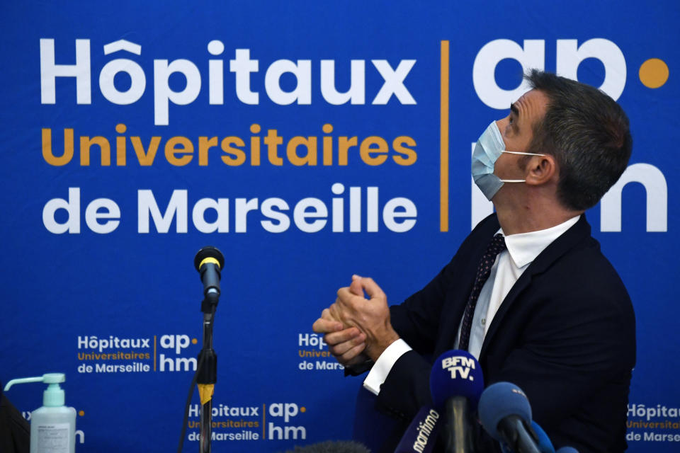 French Health Minister Olivier Veran holds a press conference at La Timone public hospital, Friday Sept. 25, 2020 in Marseille, southern France. Angry restaurant and bar owners demonstrated in Marseille to challenge a French government order to close all public venues as of Saturday to battle resurgent virus infections. The government argues that hospitals in this Mediterranean city are under strain and the closures are the only way to stem the spread while avoiding new lockdowns. (Christophe Simon, Pool via AP)