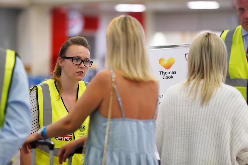 British government officials assist Thomas Cook passengers after the collapse of the travel firm, at Malta International Airport, Malta September 23, 2019. REUTERS/Darrin Zammit Lupi