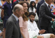Italy's Matteo Berrettini watches Kate, Duchess of Cambridge, and the Duke of Kent arrive for the presentation ceremony for the men's singles final match on day thirteen of the Wimbledon Tennis Championships in London, Sunday, July 11, 2021. (AP Photo/Alberto Pezzali)