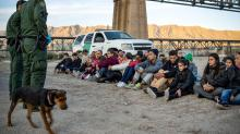 Mexico begins busing migrants to southern border as they await asylum trials