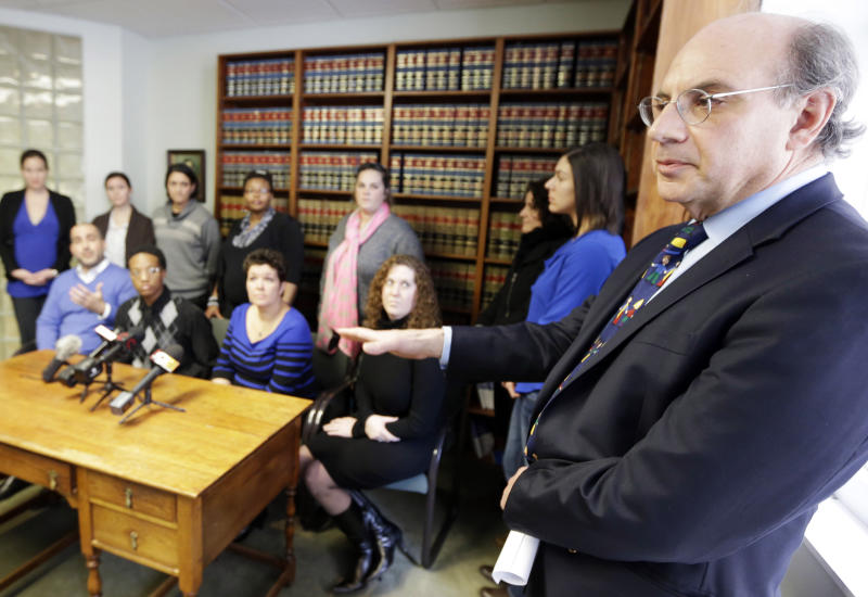 Attorney Alphonse Gerhardstein, right, answers questions Monday, Feb. 10, 2014, during a news conference in Cincinnati. Four legally married gay couples filed a federal civil rights lawsuit Monday seeking a court order to force Ohio to recognize same-sex marriages on birth certificates despite a statewide ban. (AP Photo/Al Behrman)