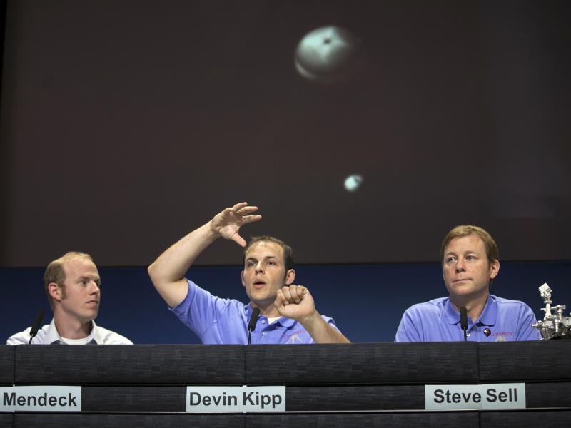 Gavin Mendeck, member of MSL entry, descent and landing team, NASA Johnson Space Center, Houston, Devin Kipp, member of MSL entry, descent and landing team, JPL and Steve Sell, member of MSL entry, descent and landing team, JPL, describe the timing of the MSL parachute deployment during Curiosity Mars landing, at a news briefing at NASA's Jet Propulsion Laboratory in Pasadena, Calif., Friday, Aug. 10, 2012.(AP Photo/Damian Dovarganes)