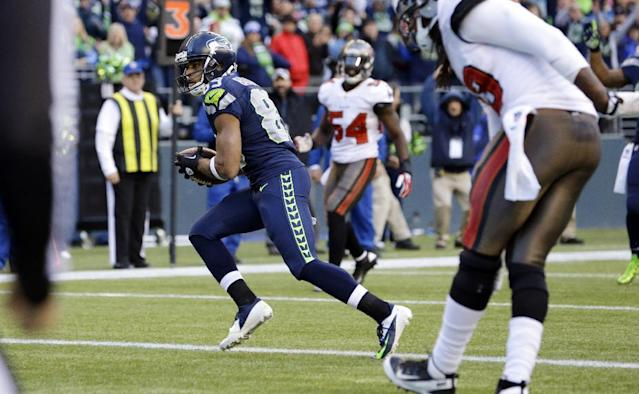 Seattle Seahawks' Doug Baldwin, left, scores a touchdown on a reception in the second half of an NFL football game against the Tampa Bay Buccaneers, Sunday, Nov. 3, 2013, in Seattle. (AP Photo/Elaine Thompson)