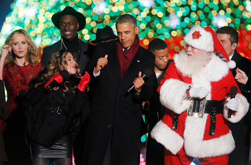 U.S. President Barack Obama dances with participants during the 92nd annual National Christmas Tree Lighting, December 4, 2014.