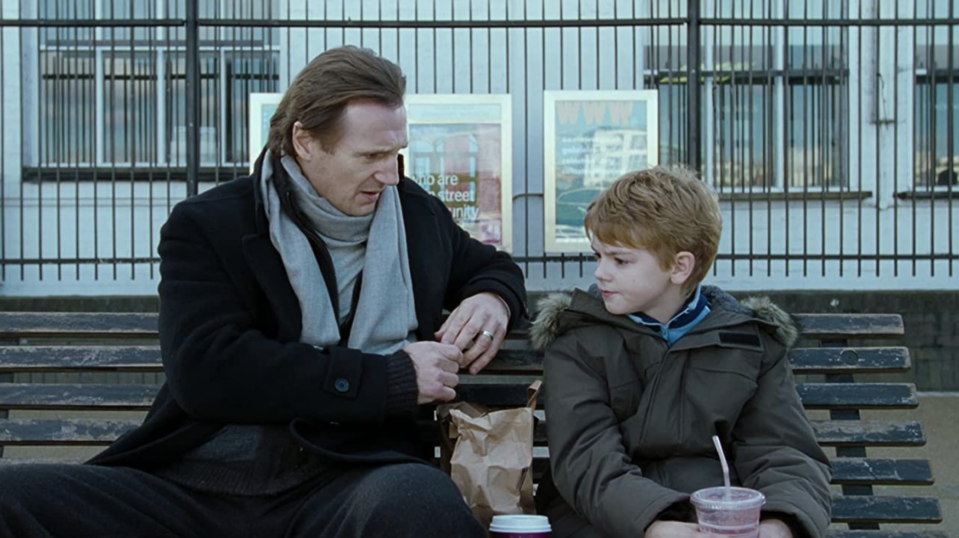 Liam Neeson and Thomas Brodie-Sangster in Love Actually (2003).