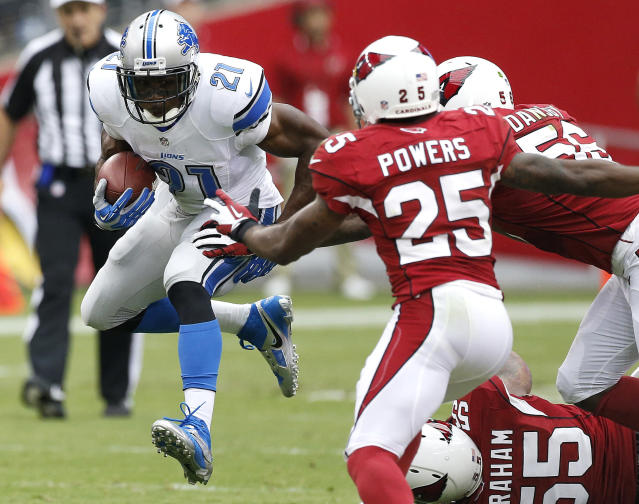 Detroit Lions running back Reggie Bush (21) gains yards as Arizona Cardinals inside linebacker Karlos Dansby (56) John Abraham (55) and Jerraud Powers (25) defend during the first half of a NFL football game, Sunday, Sept. 15, 2013, in Glendale, Ariz. (AP Photo/Darryl Webb)