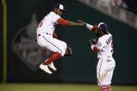 Washington Nationals center fielder Victor Robles, left, and second baseman Josh Harrison celebrate the team's 3-2 win in a baseball game against the St. Louis Cardinals, Tuesday, April 20, 2021, in Washington. (AP Photo/Nick Wass)