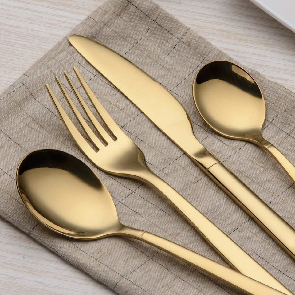 "<p>Instead of bringing a plant to your friend's holiday housewarming just like everyone else, consider gifting some gorgeous flatware. This stainless steel Berglander set comes as a service set for four, with 20 pieces — dinner spoons, dinner forks, dinner knives, tea spoons, and tea forks — that come in five color options including this stunning burnished gold.</p> <p>$35 (<a href=""https://www.amazon.com/dp/B07BWBXBKZ"" rel=""nofollow"">Shop Now</a>)</p>"