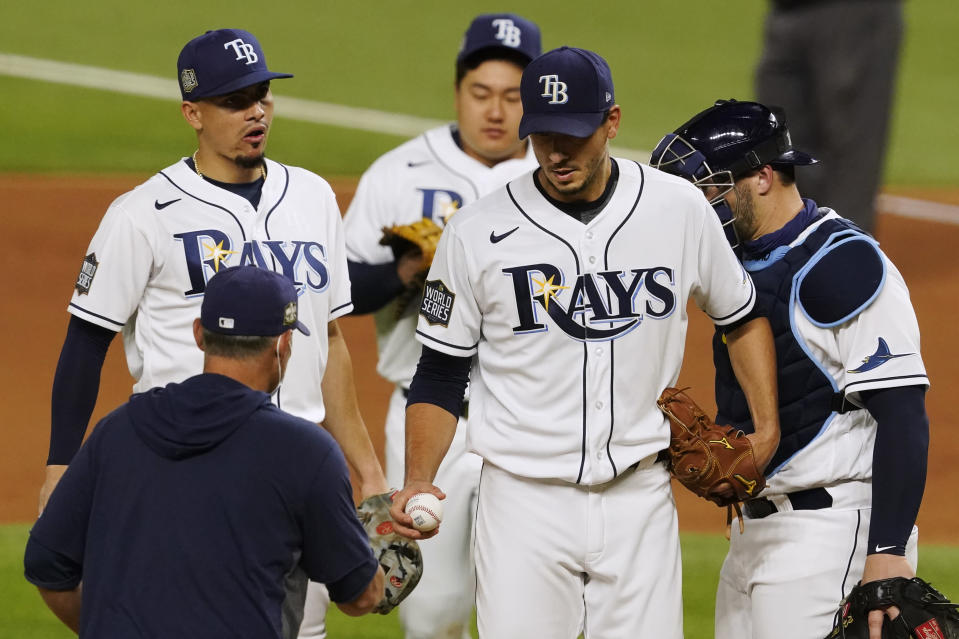 Tampa Bay Rays starting pitcher Charlie Morton leaves the game against the Los Angeles Dodgers during the fifth inning in Game 3 of the baseball World Series Friday, Oct. 23, 2020, in Arlington, Texas. (AP Photo/Tony Gutierrez)
