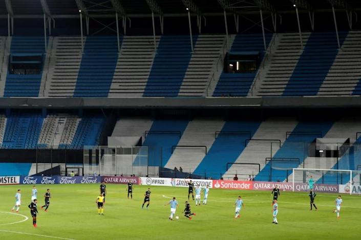 The Copa Libertadores Group F football match between Argentina's Racing Club and Peru's Alianza Lima is played in an empty stadium due to the new coronavirus (AFP Photo/AGUSTIN MARCARIAN)