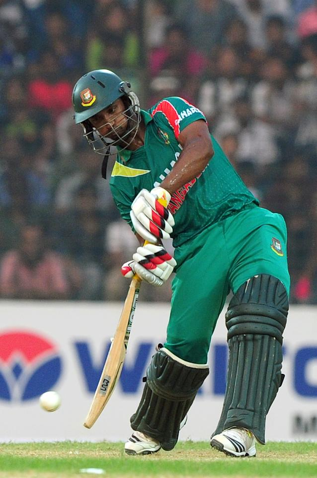 Bangladesh batsman Naeem Islam plays a shot during the third One-Day International (ODI) cricket match between Bangladesh and New Zealand at Khan Jahan Ali Stadium in Fatullah on the outskirts of Dhaka on November 3, 2013 . AFP PHOTO/ Munir uz ZAMAN        (Photo credit should read MUNIR UZ ZAMAN/AFP/Getty Images)