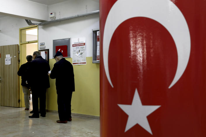 Voters wait in the line for cast their ballots at a polling station during the local elections in Ankara, Turkey, Sunday, March 31, 2019. Turkish citizens have begun casting votes in municipal elections for mayors, local assembly representatives and neighborhood or village administrators that are seen as a barometer of Erdogan's popularity amid a sharp economic downturn. (AP Photo/Ali Unal)