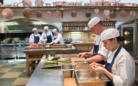 The staff work in a well-equipped kitchen - Credit: PA