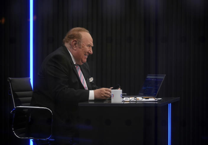 """Presenter Andrew Neil prepares to broadcast from a studio during the launch event for new TV channel GB News in London, Sunday June 13, 2021. A new news channel launched on British television on Sunday evening with the aim of giving a voice """"to those who feel sidelined or silenced."""" GB News, which is positioning itself as a rival to the news and current affairs offerings of the likes of BBC and Sky News, denies it will be the British equivalent of Fox News. However, it clearly wants to do things differently. (Yui Mok/PA via AP)"""