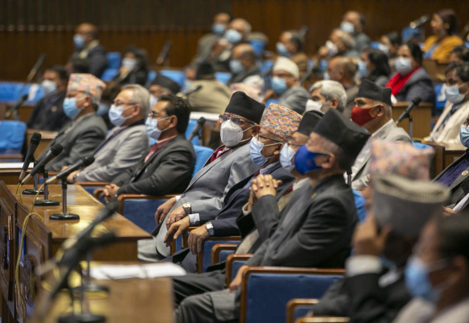 Members of parliament sit as they begin session in Kathmandu, Nepal, Sunday, March 7, 2021. Nepal's Parliament reinstated by the nation's Supreme Court began session on Sunday that would likely determine the future of the prime minister and government. (AP Photo/Niranjan Shrestha)