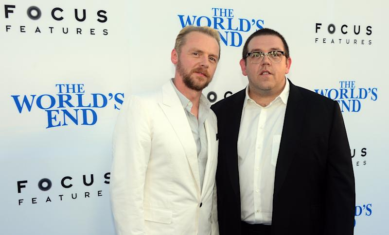 Actors Simon Pegg and Nick Frost pose on arrival for the L.A. Premiere of the film 'The World's End' in Hollywood, California, on August 21 2013. AFP PHOTO/Frederic J. BROWN (Photo credit should read FREDERIC J. BROWN/AFP/Getty Images)