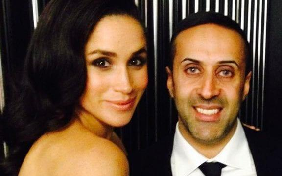 Mansoor Hussain posing with the Duchess of Sussex at a gala event in 2013