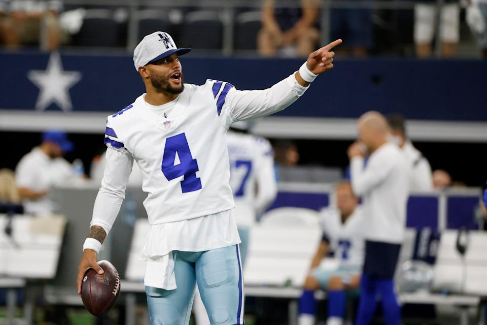 Dallas Cowboys' Dak Prescott gestures as he stands on the field during warmups before a preseason NFL football game against the Houston Texans in Arlington, Texas, Saturday, Aug. 21, 2021.