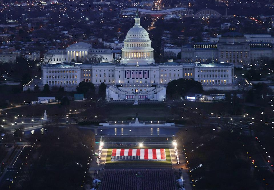 The striking display fills the space where thousands of people would usually stand to witness history unfold. (Photo: JOE RAEDLE via Getty Images)