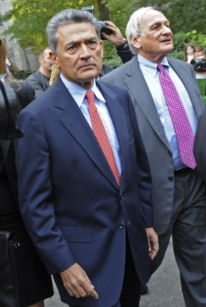 FILE - In this Dec. 21, 2009 file photo, Rajat Gupta exits Manhattan federal court in New York with his attorney Gary Naftalis, right, following arraignment. The insider trading trial of the former board member for Goldman Sachs and Procter & Gamble begins in New York on Monday, May 21, 2012, with jury selection. (AP Photo/ Louis Lanzano, File)