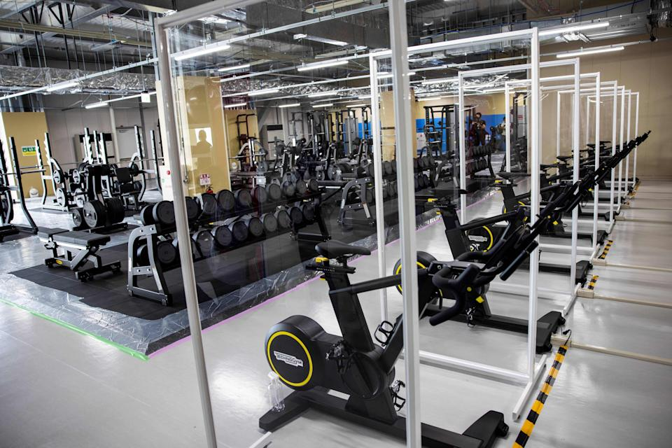 Partitions are seen installed at the fitness centre to prevent the spread of the Covid-19 coronavirus during a media tour of the Tokyo 2020 Olympic and Paralympic Village in Tokyo on June 20, 2021.