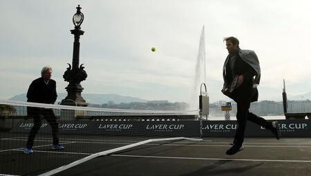 Switzerland's Roger Federer returns the ball to Bjorn Borg of Sweden (L) during a tennis session to promote the Laver Cup tennis tournament on a temporary court on the banks of Lake Geneva in Geneva, Switzerland February 8, 2019. REUTERS/Arnd Wiegmann
