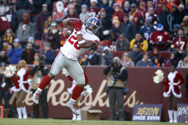 New York Giants running back Saquon Barkley catches a touchdown pass from quarterback Daniel Jones during the first half of an NFL football game against the Washington Redskins, Sunday, Dec. 22, 2019, in Landover, Md. (AP Photo/Alex Brandon)