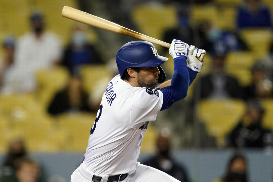 Los Angeles Dodgers' Chris Taylor drives in a run with a single during the fifth inning of a baseball game against the San Francisco Giants Friday, May 28, 2021, in Los Angeles. (AP Photo/Marcio Jose Sanchez)