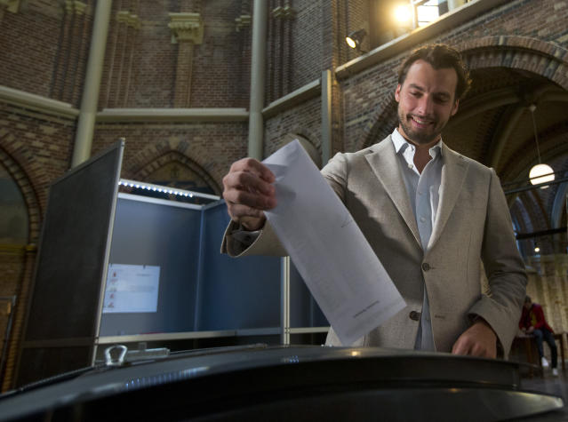 Thierry Baudet, leader of the populist party Forum for Democracy, casts his ballot for the European elections in Amsterdam, Netherlands, Thursday, May 23, 2019. Dutch polls have opened in elections for the European Parliament, starting four days of voting across the 28-nation bloc that pits supporters of deeper integration against populist Euroskeptics who want more power for their national governments. (AP Photo/Peter Dejong)