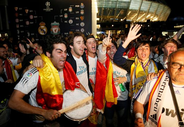 Soccer Football - Champions League Final - Real Madrid v Liverpool - Kiev, Ukraine - May 26, 2018 Real Madrid fans celebrate outside the stadium after the match REUTERS/Valentyn Ogirenko