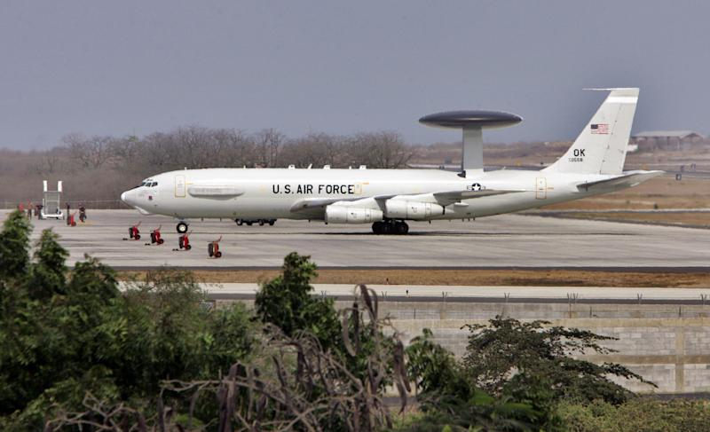 FILE - In this Dec. 14, 2006, file photo, a US military plane lands at the US base airport in Manta, Ecuador. Shortly after first taking officein 2007, Ecuadoran President Rafael Correa purged Ecuador's military of officers deemed to have close relations with U.S. counterparts. He also ended an agreement with Washington that allowed U.S. drug interdiction flights to be based at the Ecuadorean airfield in Manta. Ecuador has ordered, on April 2014, that all 20 Defense Department employees in the U.S. Embassy's military group to leave the country by month's end, The Associated Press has learned. (AP Photo/Dolores Ochoa, File)