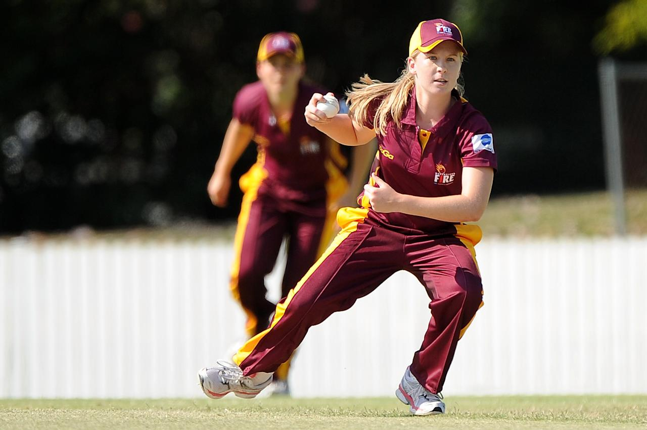 BRISBANE, AUSTRALIA - OCTOBER 11:  Jemma Barsby of the Fire fields off her own bowling during the WT20 match between Queensland and Tasmania at Allan Border Field on October 11, 2013 in Brisbane, Australia.  (Photo by Matt Roberts/Getty Images)
