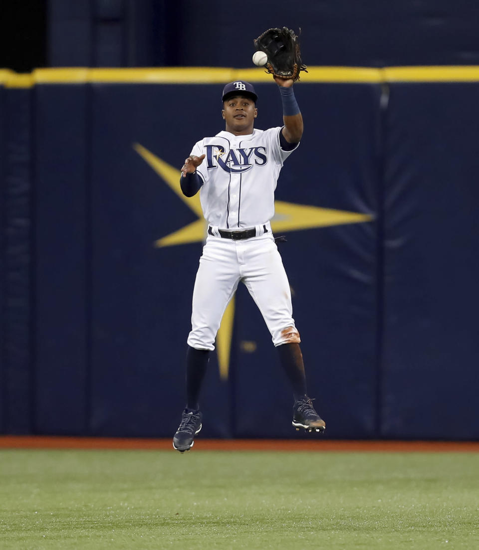 Tampa Bay Rays' Mallex Smith fields a line-drive single to center field by Miami Marlins' Derek Dietrich during the fifth inning of a baseball game Friday, July 20, 2018, in St. Petersburg, Fla. (AP Photo/Mike Carlson)