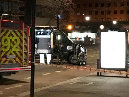 "Members of Oslo police bomb squad work at the scene the after the discovery of a ""bomb-like device"", in Oslo, Norway April 8, 2017. REUTERS/Ole Petter Skonnord"