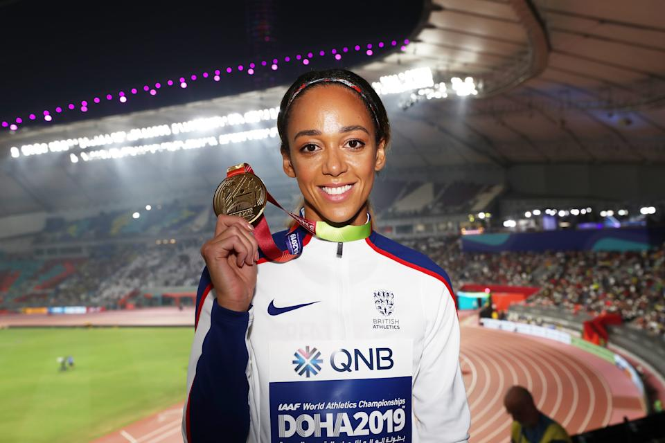 DOHA, QATAR - OCTOBER 04: Gold medalist Katarina Johnson-Thompson of Great Britain stands on the podium during the medal ceremony for the Women's Heptathlon during day eight of 17th IAAF World Athletics Championships Doha 2019 at Khalifa International Stadium on October 04, 2019 in Doha, Qatar. (Photo by Maja Hitij/Getty Images)