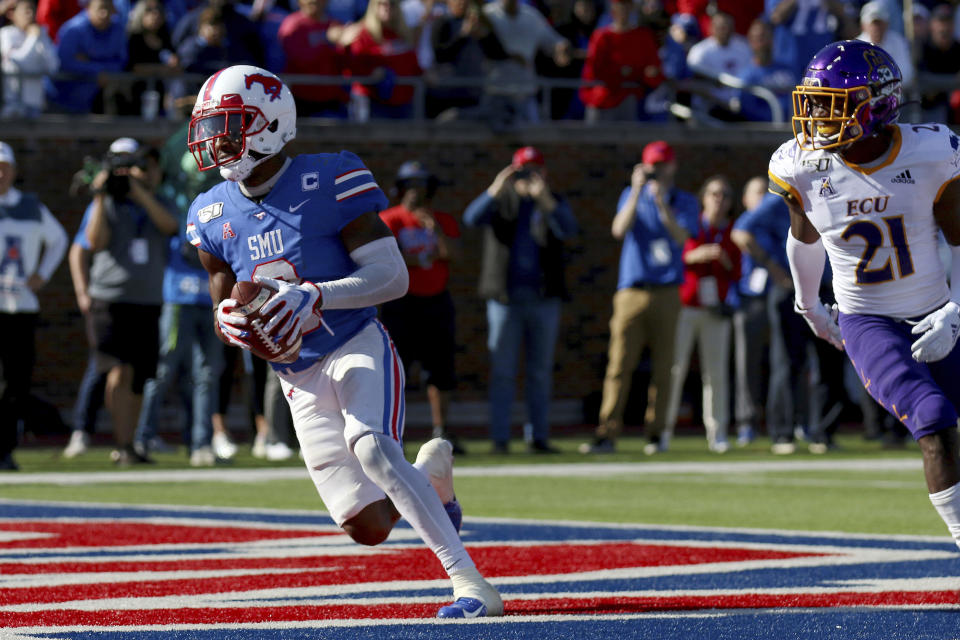 SMU wide receiver James Proche, left, catches a touchdown pass while East Carolina cornerback Ja'Quan McMillian (21) looks on during the second half of an NCAA college football game, Saturday, Nov. 9, 2019, in Dallas. (AP Photo/Roger Steinman)
