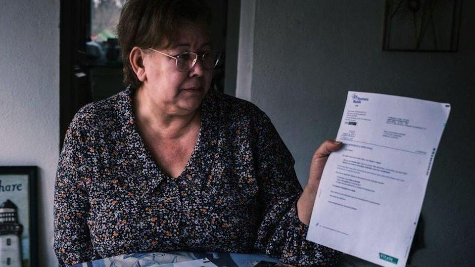 Jeanne Pouchain looks at letter telling her she`s legally dead