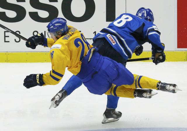 Sweden's Lucas Wallmark (L) is checked by Finland's Saku Kinnunen during the third period of their IIHF World Junior Championship gold medal ice hockey game in Malmo, Sweden, January 5, 2014. REUTERS/Alexander Demianchuk (SWEDEN - Tags: SPORT ICE HOCKEY)
