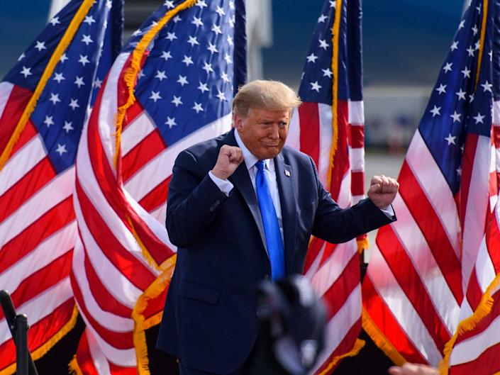 Trump addresses a crowd at a rally at the Pitt-Greenville airport, North Carolina on 15 OctoberGetty Images
