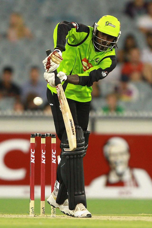 MELBOURNE, AUSTRALIA - JANUARY 08:  Chris Gayle of the Thunder plays a shot during the Big Bash League match between the Melbourne Stars and the Sydney Thunder at Melbourne Cricket Ground on January 8, 2013 in Melbourne, Australia.  (Photo by Robert Prezioso/Getty Images)
