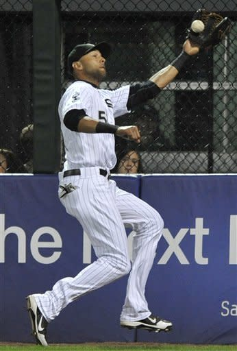 Chicago White Sox right fielder Alex Rios catches a fly ball hit by Tampa Bay Rays' Matt Joyce in the second inning during a baseball game in Chicago, Friday, Sept. 28, 2012. (AP Photo/Paul Beaty)