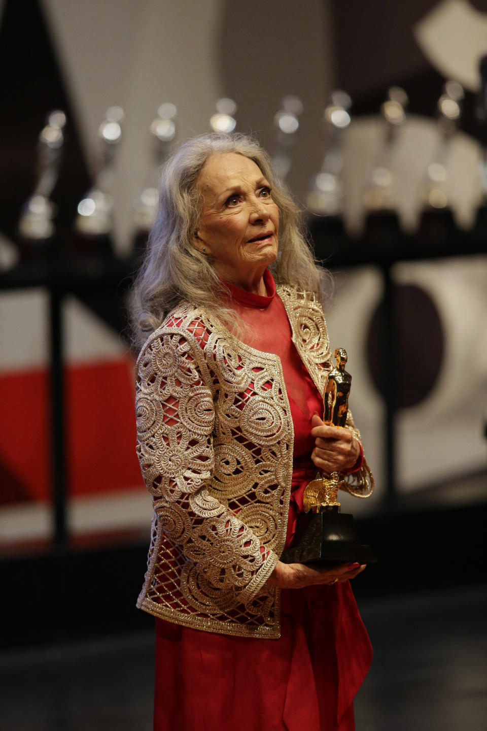 Actress Isela Vega receives the Golden Ariel for lifetime achievement, during the 59th Ariel Awards at the Palace of Fine Arts in Mexico City, Tuesday, July 11, 2017. The Ariel Awards recognize excellence in motion picture making, such as acting, directing and screen writing in Mexican cinema.(AP Photo/Rebecca Blackwell)
