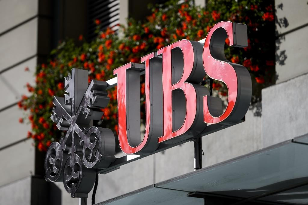 Swiss banking giant UBS posted higher profits for the second quarter (AFP Photo/FABRICE COFFRINI)