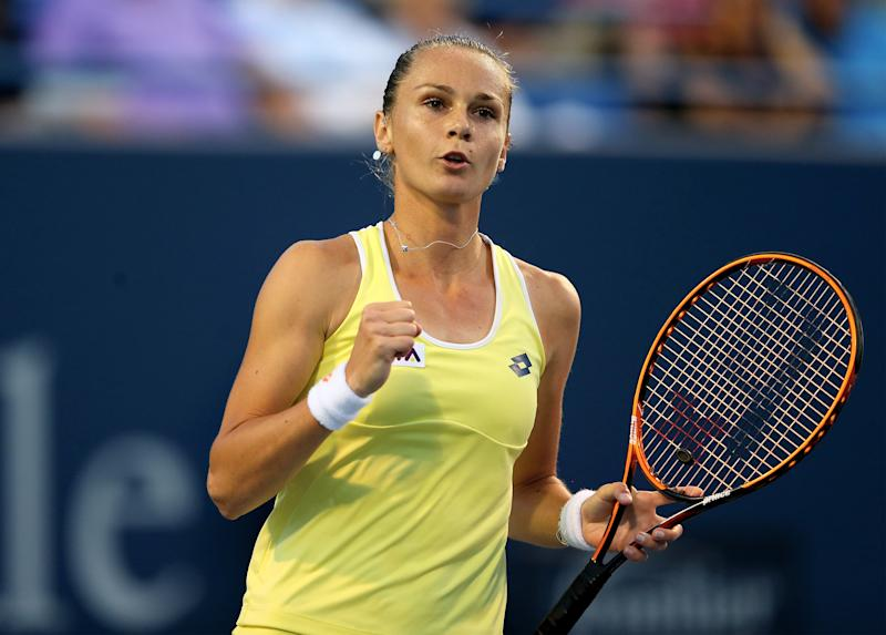 Magdalena Rybarikova of Slovakia celebrates her first set win over Simona Halep of Romania during the Connecticut Open tennis tournament, in New Haven, on August 19, 2014