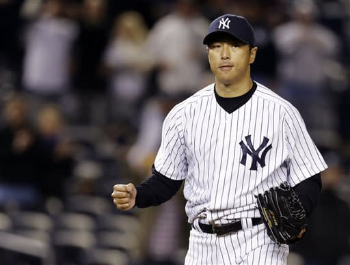 New York Yankees starting pitcher Hiroki Kuroda reacts after shutting out the Baltimore Orioles 3-0 in a baseball game at Yankee Stadium in New York , Sunday, April 14, 2013. (AP Photo/Kathy Willens)