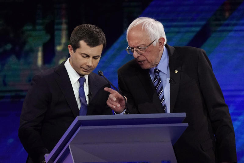 Democratic presidential candidates South Bend Mayor Pete Buttigieg, left and Sen. Bernie Sanders, I-Vt., talk during a break Thursday, Sept. 12, 2019, during a Democratic presidential primary debate hosted by ABC at Texas Southern University in Houston. (AP Photo/David J. Phillip)