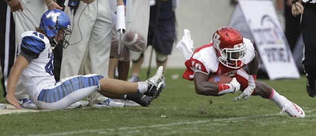 Houston' Demarcus Ayers is taken out-of-bounds by Memphis' Jake Elliott during the third quarter of an NCAA college football game at BBVA Compass Stadium Saturday, Oct. 12, 2013, in Houston. (AP Photo/Houston Chronicle, Melissa Phillip)