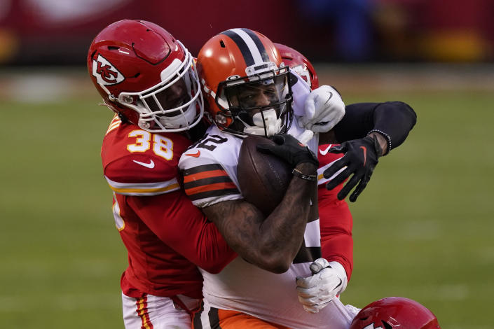 Cleveland Browns wide receiver Rashard Higgins is tackled by Kansas City Chiefs safety L'Jarius Sneed (38) after catching a pass during the second half of an NFL divisional round football game, Sunday, Jan. 17, 2021, in Kansas City. (AP Photo/Charlie Riedel)