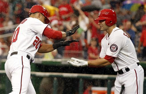 Washington Nationals' Ian Desmond, left, celebrates his solo home run with Danny Espinosa during the second inning of a baseball game with the Atlanta Braves at Nationals Park on Tuesday, Aug. 21, 2012, in Washington. (AP Photo/Alex Brandon)